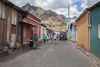Lake Atitlan, Guatemala.  Kids and locals walk thru the village of San Juan La Laguna.