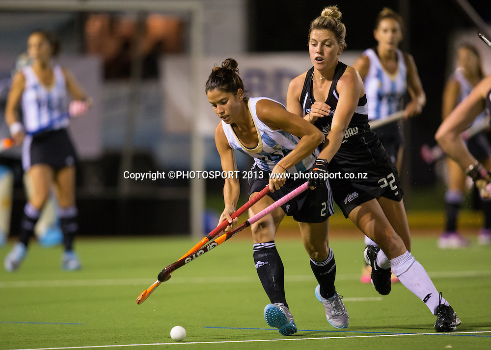 Argentina's Mariela Scarone and Black Sticks' Gemma Flynn tussle for the ball during the four nations hockey match between New Zealand Black Sticks Women and Argentina at Gallagher Hockey Centre, Hamilton, New Zealand, 17 April 2013.  Photo: Stephen Barker/photosport.co.nz