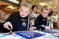 "Cadburys Spots vs Stripes Challenge Race Season Meadowhall Sheffield.Luke and Matthew Chadwick compete for the ""Fastest Coin Stacker"".2 April 2011.Images © Paul David Drabble"