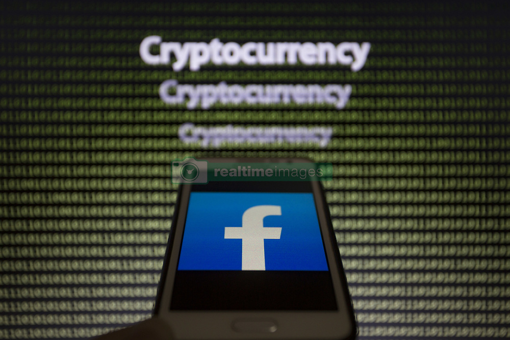 May 24, 2019 - Asuncion, Paraguay - Facebook logo icon is seen on a smartphone screen against the text cryptocurrency and binary code text unfocused on background. (Credit Image: © Andre M. Chang/ZUMA Wire)