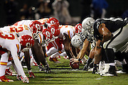 The Oakland Raiders offensive line gets set to snap the ball opposite the Kansas City Chiefs defensive line at the line of scrimmage during the NFL week 12 regular season football game against the Kansas City Chiefs on Thursday, Nov. 20, 2014 in Oakland, Calif. The Raiders won their first game of the season 24-20. ©Paul Anthony Spinelli