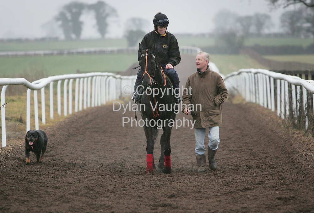 "7/3/2006.Willie Mullins pictured on the gallops in Carlow with Ruby Walsh on ""Mr Hight"" and his dog Cybil..Picture Dylan Vaughan."