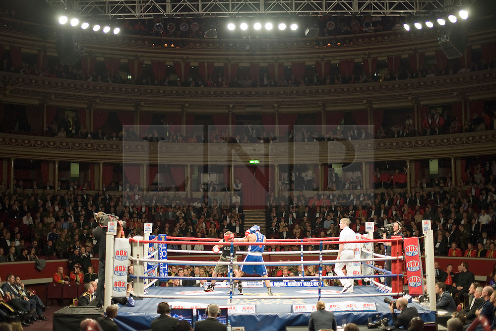 © Licensed to London News Pictures. London, UK  07/10/2011. DAVIS FEARBER, US Naval Academy (Left) Vs JOEL KIRBY, Royal Navy (Right).  Members of the UK and US Armed Forces take part in the Royal Albert Hall cup boxing match. This is the first time a boxing event has taken place in the historic venue following a court ruling banning the use of the hall for boxing and wrestling in 1999. The Court of Appeal subsequently overturned the decision earlier this year. The venue has hosted some of the greatest names in British boxing including Sir Henry Cooper, Frank Bruno, Lennox Lewis and Prince Naseem Hamed. Photo credit: Ben Cawthra/LNP
