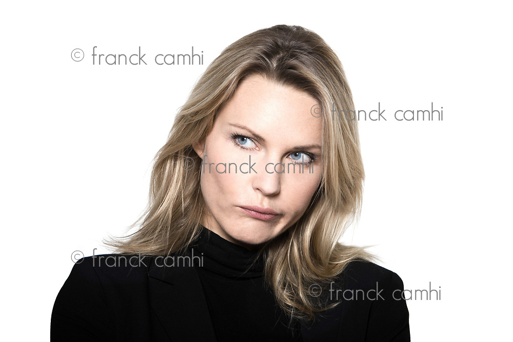 beautiful blond hair woman mistrust frown confused portrait on studio white isolated background