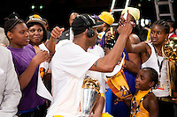 17 June 2010: Guard Kobe Bryant of the Los Angeles Lakers celebrates and hugs Ron Artest's children after the Lakers defeat the Boston Celtics 83-79 and win the NBA championship in Game 7 of the NBA Finals at the STAPLES Center in Los Angeles, CA.