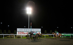 Chica De La Noche (nearside) ridden by Adam Kirby wins the 100% Profit Boost at 32Redsport.com Fillies' handicap stakes at Kempton Park Racecourse, Esher.
