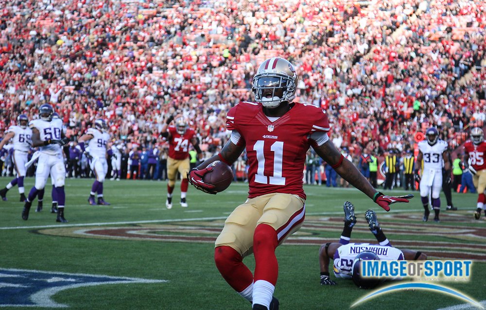Aug 25, 2013; San Francisco, CA, USA; San Francisco 49ers wide receiver Quinton Patton (11) celebrates after catching a 5-yard touchdown pass against the Minnesota Vikings at Candlestick Park.