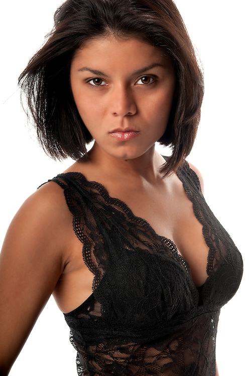 Young and attractive woman with lingerie looking at camera.