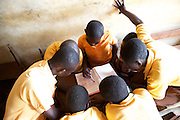 Students learning in groups in  a classroom at Tonga Junior High School, Ghana.