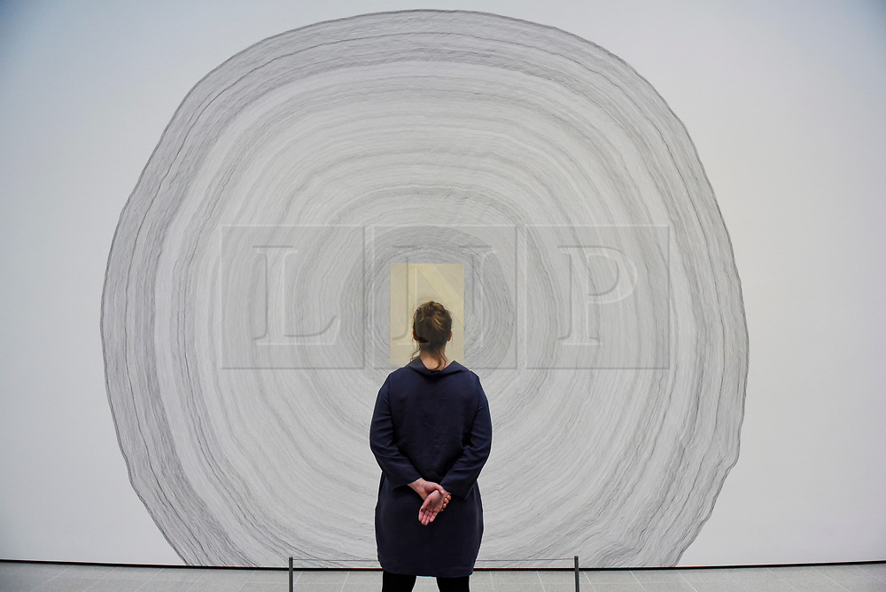 """© Licensed to London News Pictures. 02/03/2020. LONDON, UK. A staff member views """"Propagazione"""", 1995-2020, by Giuseppe Penone. Preview of """"Among The Trees"""" exhibition at the Hayward Gallery on the Southbank.  Artworks by 38 international artists explore man's relationship with trees and forests at a time when the destruction of forests is accelerating in show which runs 4 March to 17 May 2020.  Photo credit: Stephen Chung/LNP"""