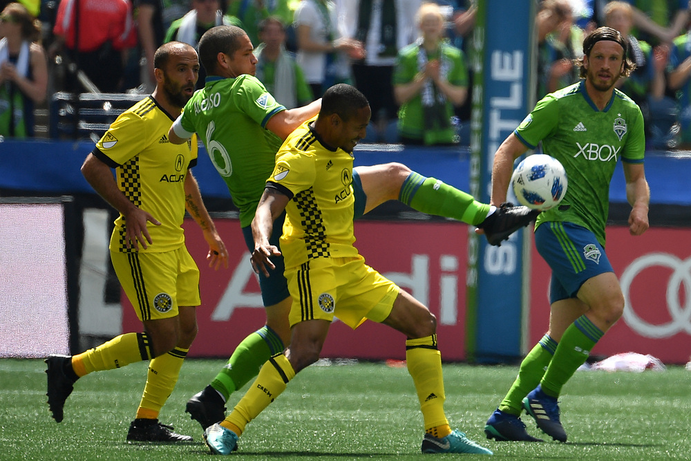 May 05, 2018; Seattle, Washington, US;  Seattle Sounders midfielder Osvaldo Alonso (6) gets his fit on the ball trying to keep it away from the Crew during in action between the Seattle Sounders FC and Columbus Crew at Century Link Field. Photo credit: Rick May - Rick May Photography