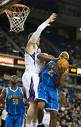 November 29, 2009; Sacramento, CA, USA;  New Orleans Hornets guard Devin Brown (23) is defended by Sacramento Kings forward Andres Nocioni (5) during the first quarter at the ARCO Arena. Sacramento defeated New Orleans 112-96.