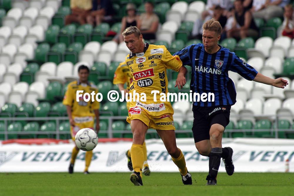 02.08.2003, Veritas Stadion, Turku, Finland..Veikkausliiga 2003 / Finnish League 2003.FC Inter Turku v Kuopion Palloseura.Jussi Markkanen (KuPS) v Ari Nyman (Inter).©Juha Tamminen