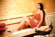 Hispanic Woman Sitting In The Dry Sauna