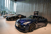 People look at new GT-R at the showroom of the headquarters of Japan's auto giant Nissan Motor in Yokohama, in suburban Tokyo, on July 27, 2016.<br /> Nissan is expected to announce its financial result of the first quarter from April to June 2016. 26/07/2016-Yokohama, JAPAN