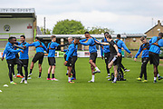 The FGR players warm up prior to training during the Forest Green Rovers Press Conference and Training session at the New Lawn, Forest Green, United Kingdom on 12 May 2017. Photo by Shane Healey.