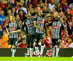 27.08.2013, Anfield, Liverpool, ENG, League Cup, FC Liverpool vs Notts County FC, 2. Runde, im Bild Notts County's Yoann Arquin celebrates with team-mates Callum McGregor, Manny Smith and Jamal Campbell-Ryce after scoring his side's first goal against Liverpool during the English League Cup 2nd round match between Liverpool FC and Notts County FC, at Anfield, Liverpool, Great Britain on 2013/08/27. EXPA Pictures © 2013, PhotoCredit: EXPA/ Propagandaphoto/ David Rawcliffe<br /> <br /> ***** ATTENTION - OUT OF ENG, GBR, UK *****