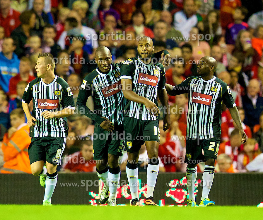 27.08.2013, Anfield, Liverpool, ENG, League Cup, FC Liverpool vs Notts County FC, 2. Runde, im Bild Notts County's Yoann Arquin celebrates with team-mates Callum McGregor, Manny Smith and Jamal Campbell-Ryce after scoring his side's first goal against Liverpool during the English League Cup 2nd round match between Liverpool FC and Notts County FC, at Anfield, Liverpool, Great Britain on 2013/08/27. EXPA Pictures &copy; 2013, PhotoCredit: EXPA/ Propagandaphoto/ David Rawcliffe<br /> <br /> ***** ATTENTION - OUT OF ENG, GBR, UK *****