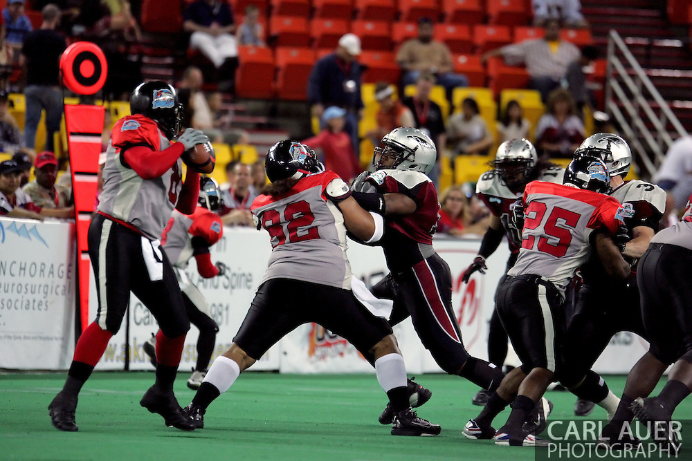 6-28-2007: Anchorage, AK -  Barracuda QB Dixie Wooten drops back to pass in the first quarter as the CenTex Barracudas hand the Alaska Wild another loss 53-47 as the Barracudas make the trip up to Alaska.