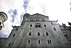 Neuschwanstein Castle is a 19th-century Romanesque Revival palace on a rugged hill above the village of Hohenschwangau near Füssen in southwest Bavaria, Germany. The palace was commissioned by Ludwig II of Bavaria as a retreat and as a homage to Richard Wagner.  The palace was intended as a personal refuge for the reclusive king, but it was opened to the paying public immediately after his death in 1886.  Since then over 60 million people have visited Neuschwanstein Castle. The palace has appeared prominently in several movies and was the inspiration for Disneyland's Sleeping Beauty Castle and later, similar structures.