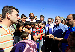 © Licensed to London News Pictures 13/09/2012.Turkey/ Syrian Refugees/ UN High Commissioner for Refugees Antonio Guterres visits Syrian refugees housed at the Öncüpinar camp, in the border province of Kilis. The camp houses up to 12,488 persons and provides homes made out from cargo containers. .Oncupinar, Turkey.Photo credit: Anna Branthwaite/LNP