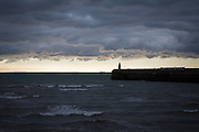 Folkestone Harbour Arm.  On a stormy day with France in the distance.