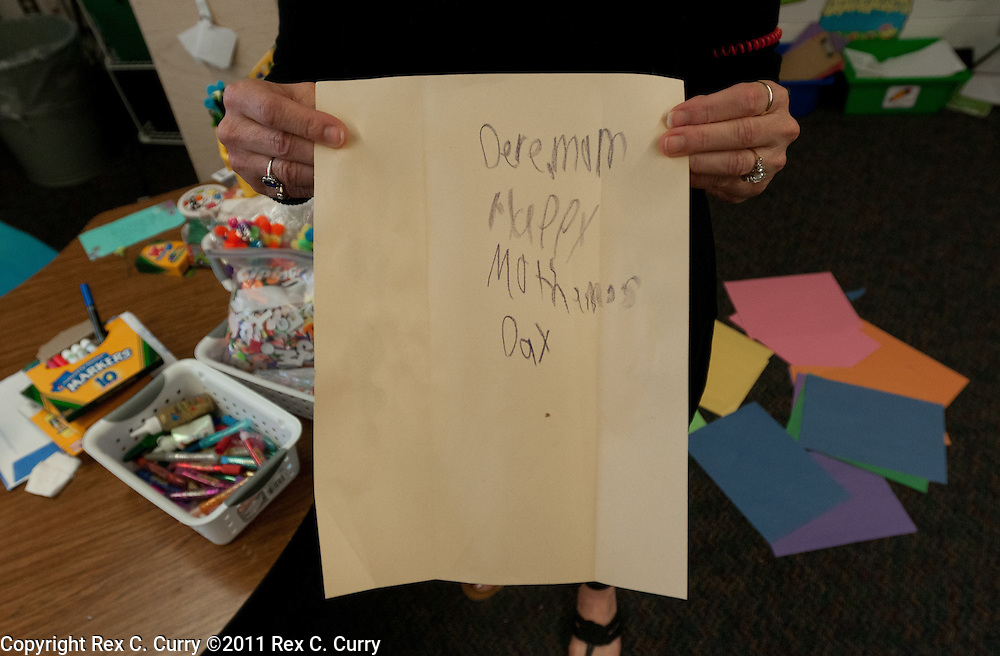 Brenda Bingham, principal at W.T Hanes Elementary School in Irving, Tx. holds a mother's day card Camden Pierce Hughes' mother wrote.  His mother, Julianne McCrery, has been charged with second degree  murder.