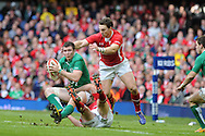 Ireland's Peter O'Mahony is tackled by Ken Owens and George North ® of Wales. RBS Six nations championship, Wales v Ireland at the Millennium stadium in Cardiff, South Wales on Saturday 2nd Feb 2013. pic by Andrew Orchard, Andrew Orchard sports photography,