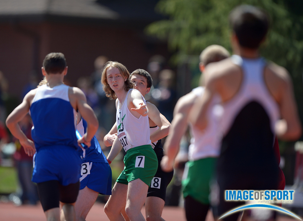 Apr 5, 2014; Stanford, CA, USA; Runners await the baton handoff in a boys 4 x 800m relay heat in the 2014 Stanford Invitational at Cobb Track & Angell  Field.