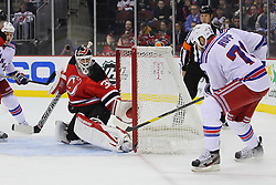 Jan 31; Newark, NJ, USA; New Jersey Devils goalie Martin Brodeur (30) makes a save on New York Rangers left wing Mike Rupp (71) during the first period at the Prudential Center.