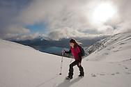 Woman (aged 40) hill walking in winter, Beinn Alligin, Torridon, Scotland