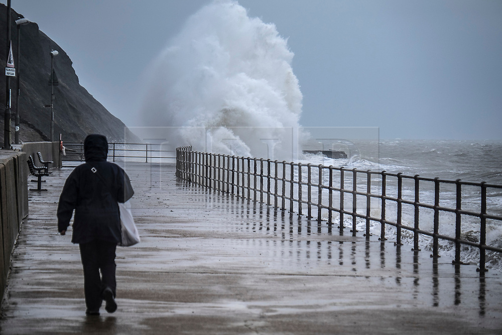 @Licensed to London News Pictures 27/01/2016. Folkestone, Kent, Large waves swamping the Sunny Sands beach today (27/01/2016) at Folkestone on the south coast of Kent. High winds and torrential rains are forecast for the most of the UK. Photo credit: Manu Palomeque/LNP