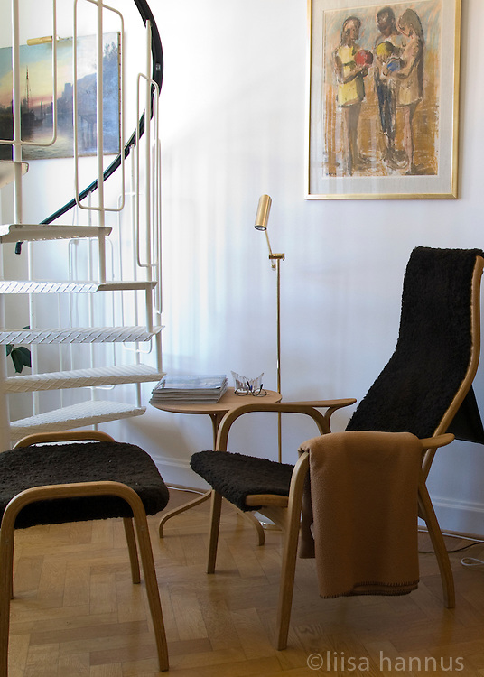 A Lamino chair and footstool designed by Yngve Ekström are the centrepieces of this bright corner.