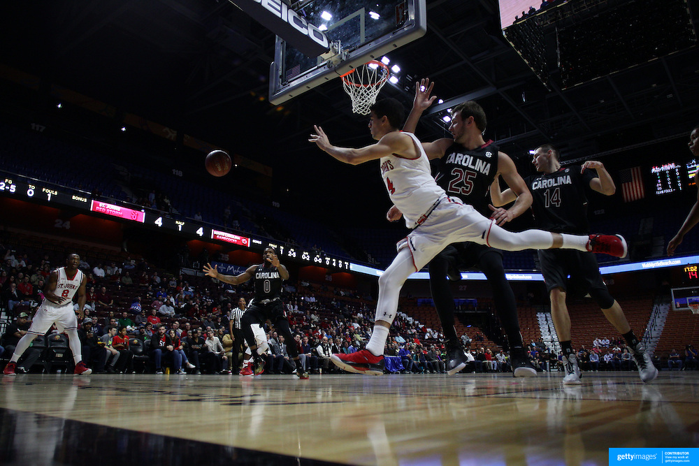 Federico Mussini, St. Johns, passes the ball out after driving to the basket during the St. John's vs South Carolina Men's College Basketball game in the Hall of Fame Shootout Tournament at Mohegan Sun Arena, Uncasville, Connecticut, USA. 22nd December 2015. Photo Tim Clayton