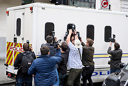 © Licensed to London News Pictures. 18/06/2016. London, UK. Photographers attempt to photograph through the window of a police escorted prison van carrying THOMAS MAIR, as it leaves Westminster Magistrates Court in London where he faced charges in connection with the shooting and stabbing of Labour MP Jo Cox. Photo credit: Ben Cawthra/LNP