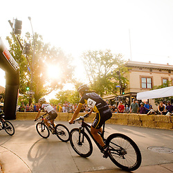 The women's field rounds a corner in downtown Grand Junction during the Grand Junction Off-Road Fat Tire Crit Friday.<br /> Photos by Brian Leddy