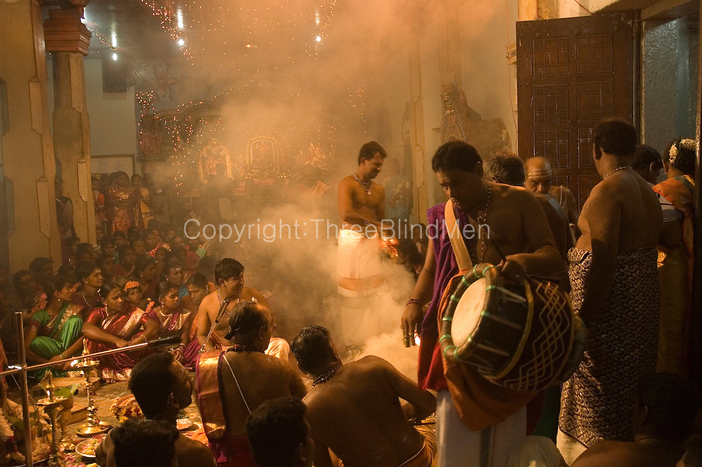 Sri Lanka. The people of the village gather during festival time for 'pujas' or special prayers in the main  Vishnu Kovil in the centre of the village.