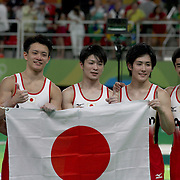 Gymnastics - Olympics: Day 3  The Japanese team of Kohei Uchimura, Ryohei Kato, Kenzo Shirai, Koji Yamamuro and Yusuke Tanaka celebrate victory after winning the gold medal in the Artistic Gymnastics Men's Team Final at the Rio Olympic Arena on August 8, 2016 in Rio de Janeiro, Brazil. (Photo by Tim Clayton/Corbis via Getty Images)