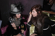 Isabella Blow and Camilla Guinness. party given by Daphne Guinness for Christian Louboutin  after the opening of his new shopt.  Baglione Hotel. 16 March 2004.  ONE TIME USE ONLY - DO NOT ARCHIVE  © Copyright Photograph by Dafydd Jones 66 Stockwell Park Rd. London SW9 0DA Tel 020 7733 0108 www.dafjones.com