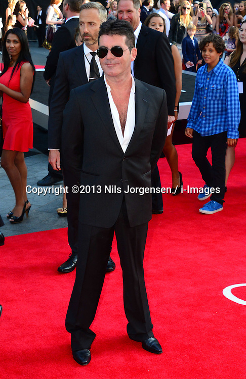 Simon Cowell arriving for the world premiere of their film One Direction: This Is Us,<br /> London, United Kingdom.<br /> Tuesday, 20th August 2013.  Picture by Nils Jorgensen / i-Images