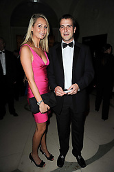 J P MAGNIER Jnr and his wife LUCY at the Cartier Racing Awards 2009 held at Claridge's, Brook Street, London on 17th November 2009.