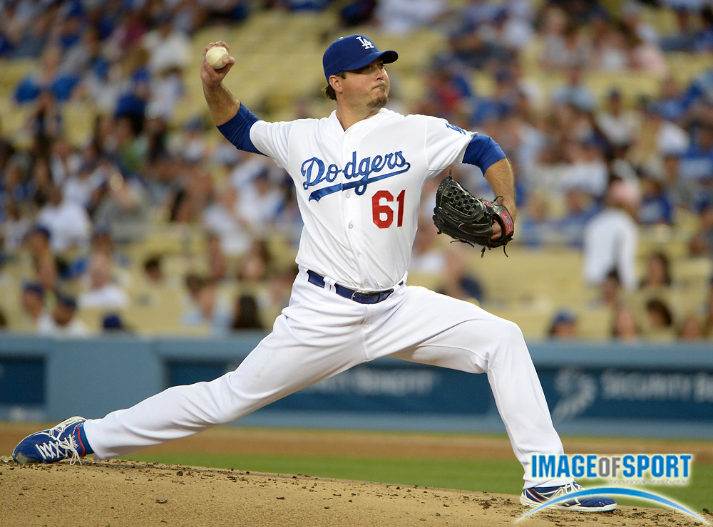 May 13, 2014; Los Angeles, CA, USA; Los Angeles Dodgers starter Josh Beckett (61) delivers a pitch against the Miami Marlins at Dodger Stadium.