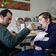 Santa Lucia Foundation, Rome, February 21, 2016. Chiara Insidioso Monda 21-year-old  and her father Maurizio, 44. 21-year-old Chiara has been hospitalized at the Santa Lucia Foundation in Rome since December 2014. In February 2014, when Chiara was only 19, she was brutally beaten by her &lsquo;partner&rsquo;, 16 years older than her, till she fell into a coma due to the violence of the blows. The kicks, punches and having her head slammed against a wall caused irreversible damage to Chiara&rsquo;s body and reduced her cerebral functioning to 10%. Chiara had to undergo three brain surgeries when she arrived at the hospital. She woke up from the coma after 10 months and is now in a state of semi-consciousness. This means that she can&rsquo;t talk, move or walk and has to be assisted in every single activity of daily life.<br />