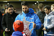 Lincoln City Manager Danny Cowley gives replica FA Cup to young fan during the The FA Cup fourth round match between Lincoln City and Brighton and Hove Albion at Sincil Bank, Lincoln, United Kingdom on 28 January 2017. Photo by Phil Duncan.
