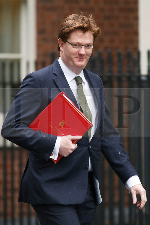 © licensed to London News Pictures. London, UK 07/01/2014. Treasury Secretary, Danny Alexander attending to a cabinet meeting in Downing Street on Tuesday, 7 January 2014. Photo credit: Tolga Akmen/LNP