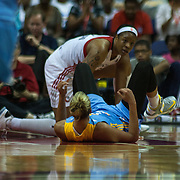 Chicago Sky Forward ELENA DELLE DONNE (11) falls on her back after colliding with Washington Mystics Center KIA VAUGHN (9) in third quarter of an WNBA regular season basketball game against the Washington Mystics Wednesday, July. 24, 2013 at The Verizon center in Washington DC.