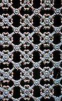 Ornamental metal grid on a grave in Montmartre