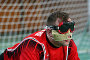 Goalball Spieler des rumaenischen Teams mit Augen- und Sichtschutz wartet auf den Anwurf der gegnerischen Mannschaft während dem internationalen Turnier in Budapest. Goalball ist eine Mannschaftssportart für blinde und sehbehinderte Menschen und wurde vom Österreicher Hans Lorenzen und dem deutschen Sepp Reindle für Kriegsinvalide entwickelt und zum ersten Mal 1946 gespielt. Die Bilder entstanden auf zwei internationalen Goalball Turnieren in Budapest und Zagreb 2007.<br /> <br /> Goalball player from the romanian team with eye and sight protection is waiting for a throw of the opponent team during an international tournament in Budapest. Goalball is a team sport designed for blind and visually impaired athletes. It was devised by an Austrian, Hanz Lorenzen, and a German, Sepp Reindle, in 1946 in an effort to help in the rehabilitation of visually impaired World War II veterans. The International Blind Sports Federatgion (IBSA - www.ibsa.es), responsible for fifteen sports for the blind and partially sighted in total, is the governing body for this sport. The images were made during two Goalball tournaments in gBudapest and Zahreb 2007.
