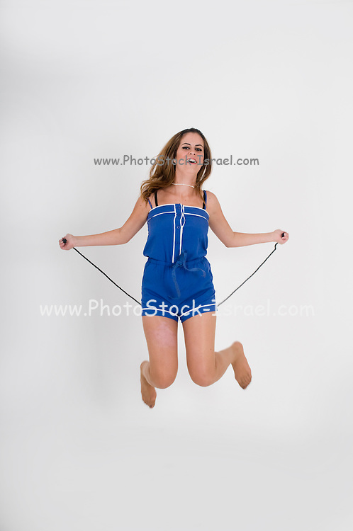 Teen Skips Rope on whte background