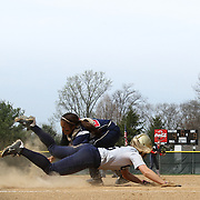 Nyack College Catcher Tesla Murillo (26) attempts to tag Goldey-Beacom pitcher Roni Peters (6) at home plate during a NCAA Central Atlantic Collegiate Conference game between Nyack College and Goldey-Beacom Saturday, April 19, 2014, at Nancy Churchmann Sawin Athletic Field in Wilmington Delaware.<br /> <br /> Goldey-Beacom defeats Nyack College 10-5 in Game 1<br /> <br /> Nyack College defeats Goldey-Beacom 1-0 in Game #2